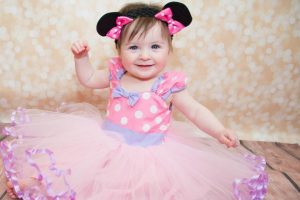 Dressing up a cute baby girl
